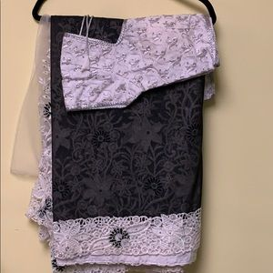 Black and white shimmer net heavy work saree